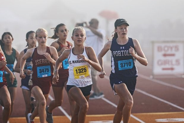Jadyn Zdanavage (right) takes the lead at the Laguna Hills Invitational on Sept. 14. As a freshman, she holds the spot of fastest female runner in the Pacific Coast League and is ranked ninth for her grade in the entire state of California.