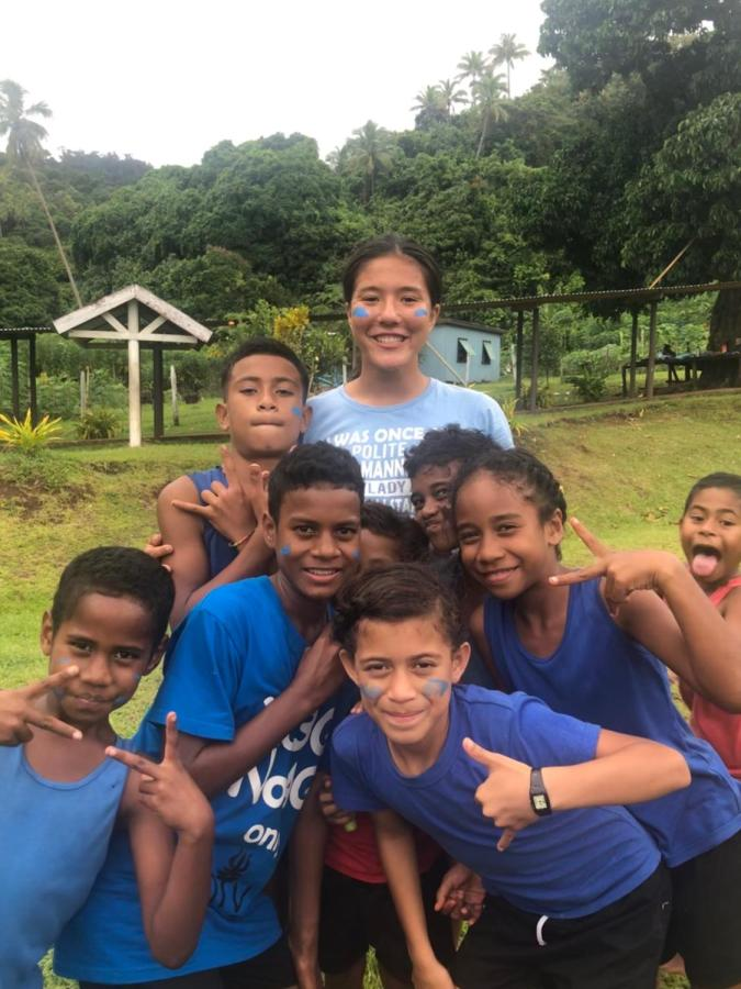 Kai Wong smiles for the camera with children from the small village of Toga, Fiji. She spent 16 days on the trip, where she participated in restoration projects and cultural activities.