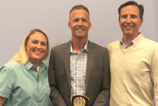 Head basketball coach Brian Smith receives the Coach of Character award at the OCADA Fall Awards Dinner, held at the Anaheim Convention Center on Sept. 30, accompanied by athletics director Katie Levensailor and principal John Pehrson. The Fall Awards Dinner is the first time in the year when one coach from each Orange County high school can be given this award for excellent character.