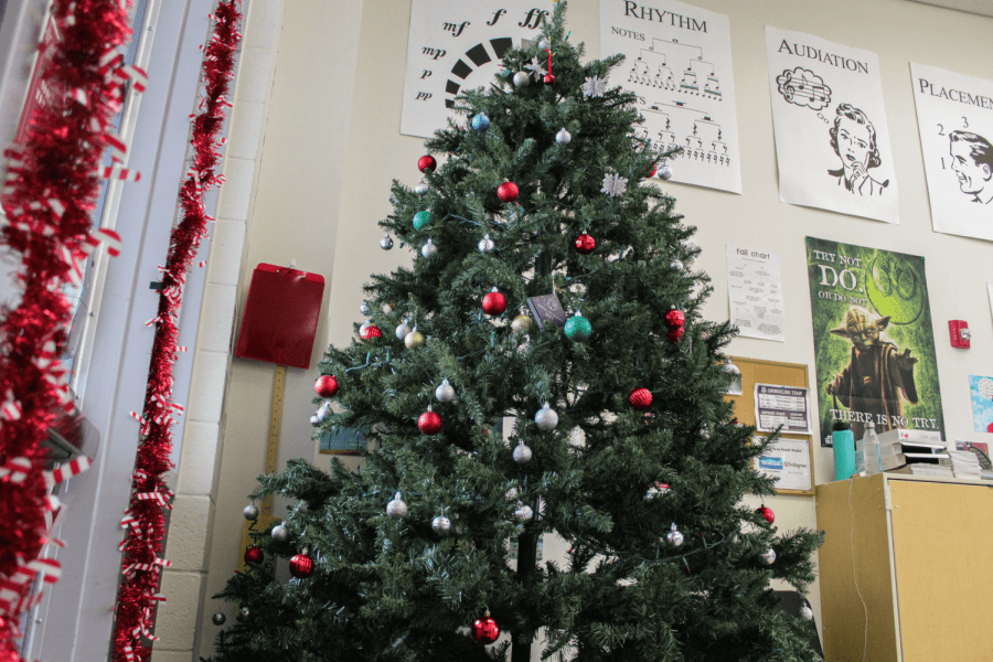Adrian Rangel-Sanchez's classroom has a tree lit with lights and red-color-schemed collection of ornaments based off his affection for lights and decorations that was developed early-on in his childhood. The decorations are something he does every year after Thanksgiving break to encourage students to get into the holiday cheer.