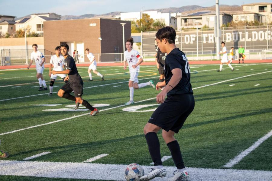 Junior Isaac Betancourt passes the ball to senior Anirudh Chaudhary, a prime example of Portola's possession based offense.