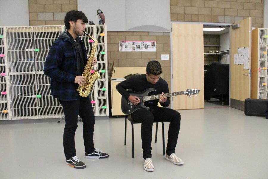 """The soulful tones of senior Yash Menon's guitar and lyrical style of senior Shivank Gupta's saxophone fill the air as their unique sounds come together in their rendition of Adele's """"Rolling in the Deep."""" The exciting combination of smooth jazz and striking rock forms melodious versatility that could not be accomplished with just one instrument."""