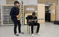 "The soulful tones of senior Yash Menon's guitar and lyrical style of senior Shivank Gupta's saxophone fill the air as their unique sounds come together in their rendition of Adele's ""Rolling in the Deep."" The exciting combination of smooth jazz and striking rock forms melodious versatility that could not be accomplished with just one instrument."