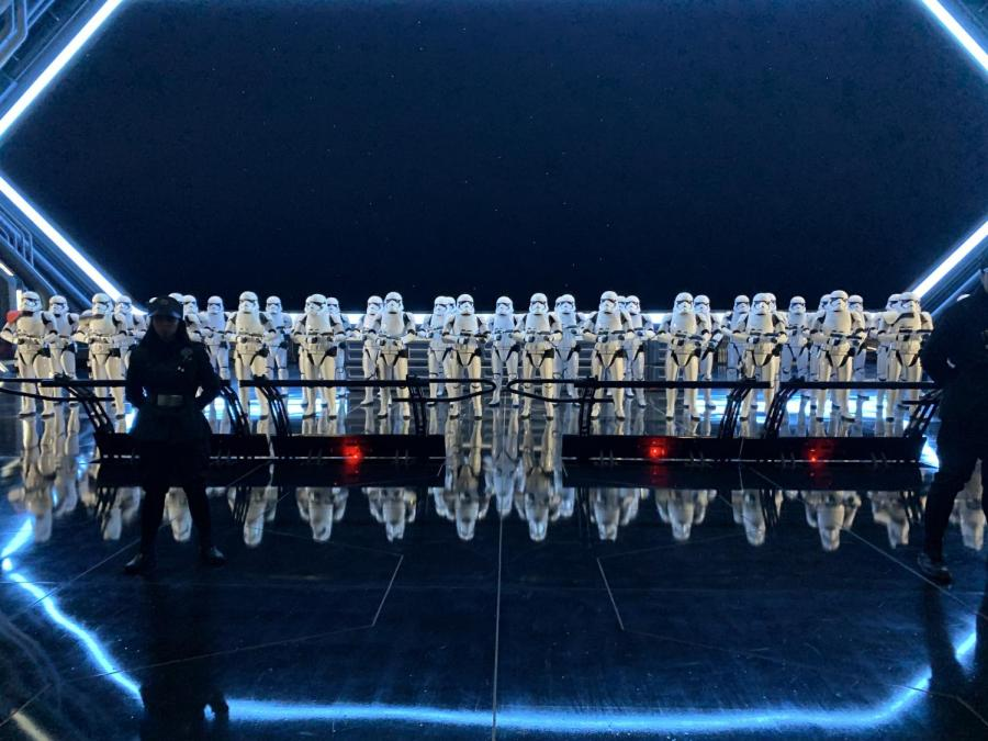 As guests get ready to board the ride, an army of Stormtroopers are there  guarded by cast members dressed as soldiers for the First Order to contribute to the theming of the ride.