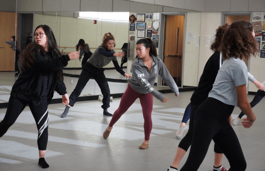 Junior Eunseo Kwon and senior Faith Nguyen warm up for their modern dance class, disregarding form and allowing momentum to be released. Modern dance began as a rejection of classical ballet, giving performers the freedom to step outside of the traditional set of movements.