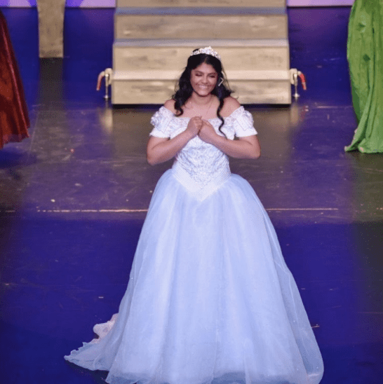 """Junior Raksha Rajeshmohan played the lead role in the spring """"Cinderella"""" musical. By watching and writing about other local theater productions, she was able to utilize her unique perspective to improve her performance on stage."""