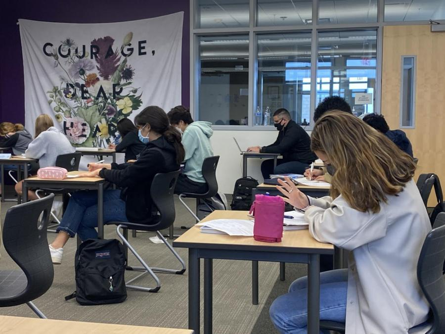 Literary and language arts teacher Doris Schlothan's American Literature class spent the period reading the Great Gatsby, which every student had a copy of.