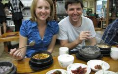 """Pictured in September 2010, Madeline and her husband Jason Greenwood eat sundubu-jjigae at her favorite restaurant in Wonju, South Korea. Greenwood keeps in touch with some of her Korean co-workers and students she worked with while she was an ESL teacher at a middle school. """"I'm Facebook friends with some of the students that were 13 when I taught them,"""" Greenwood said. """"It's almost ten years ago now, and they're 23, and they graduated college. It's so fun to see them."""""""