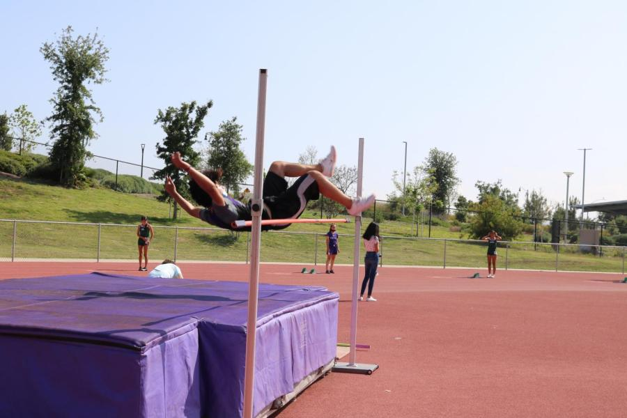 Junior Aryan Shrivastava breaks his personal record and school record by jumping a height of 5 feet 8 inches, approximately the height of a full grown adult. While the concept of the event is seemingly simple, gaining enough momentum and power to jump high enough backwards while also making sure the entire body is in line is very difficult.