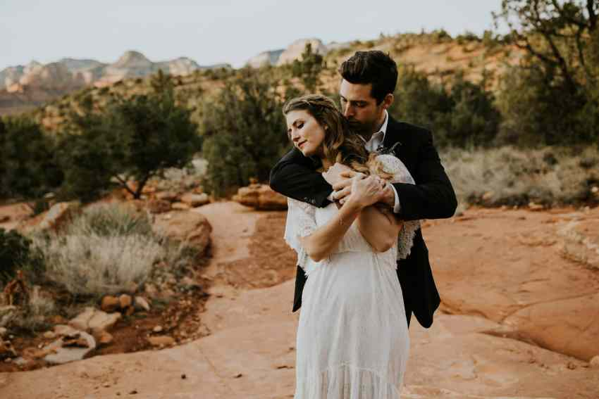 bride and groom embrace in sedona