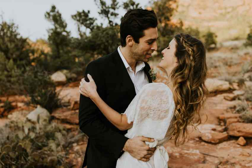 bride and groom almost kissing sedona
