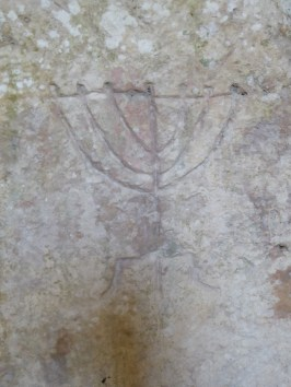 Ancient carving of a menorah