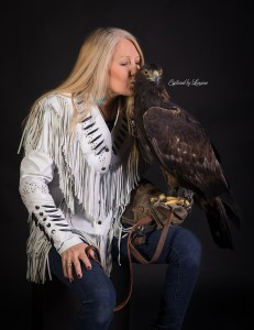 Falconer with Golden eagle portrait