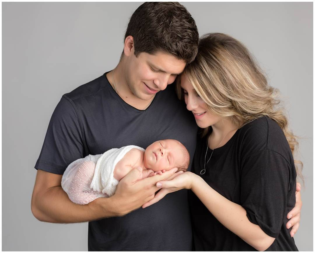Newborn with family portrait