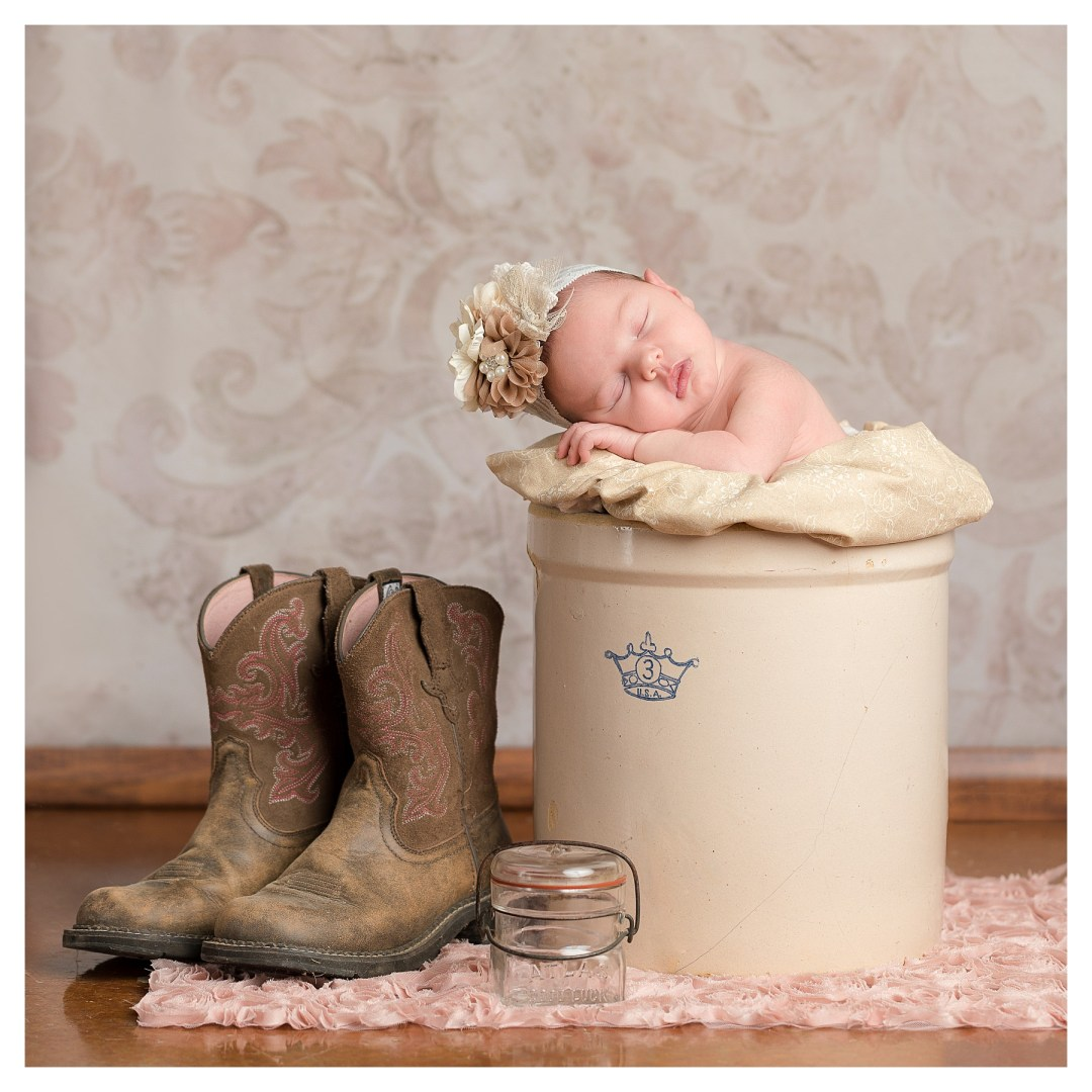 newborn in antique crock with cowboy boots