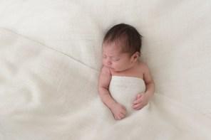 baby boy under blanket