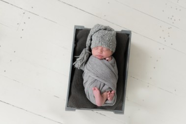 baby in crate gray