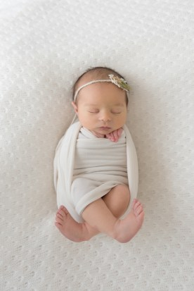 baby girl wrapped feet out