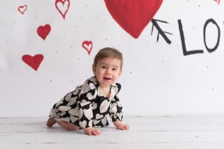 valentines day mini baby girl crawling