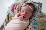 yawning baby in floral