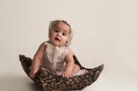 vintage baby girl sitting in basket