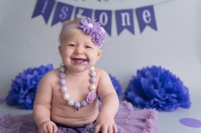 baby girl laughing in purple