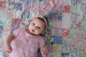 baby girl on quilt in pink