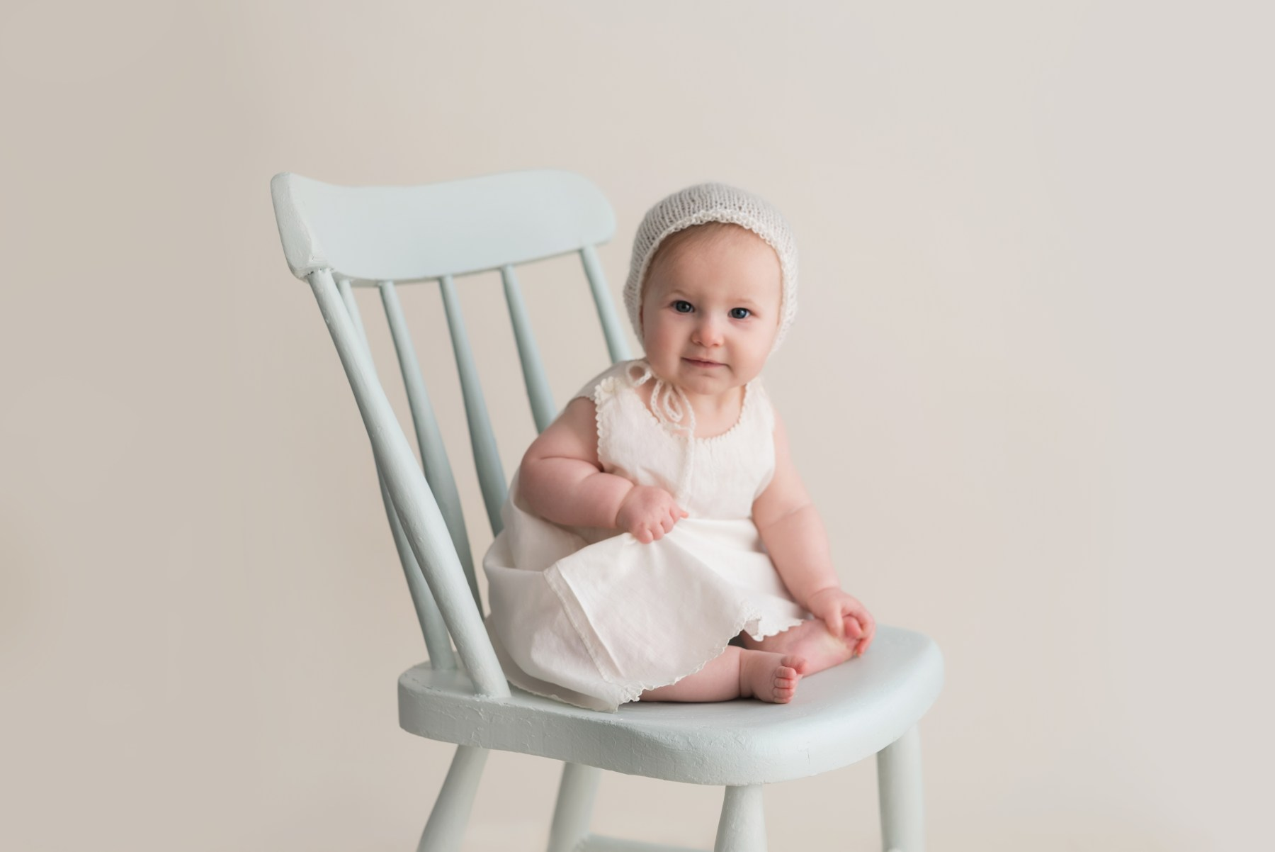 vintage baby on chair