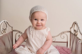 baby smirk in bonnet
