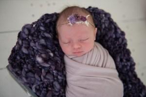 baby in girl in purple wrap