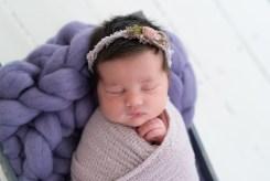 baby girl on purple bump blanket