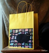 Mewsette on the Afghan gift bag, yellow