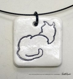 """Back to Front"" pendant, 1"" x 1"" square."