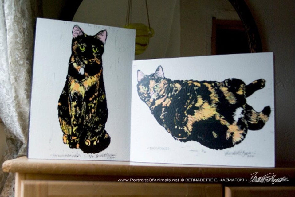 Set of Tortie Girls wood-mounted prints.