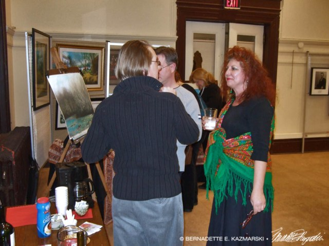 Visitors browse my exhibit after the reading.