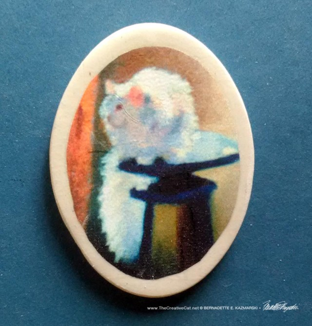 """White Cat Reflecting 1.5"""" Oval Magnet"""