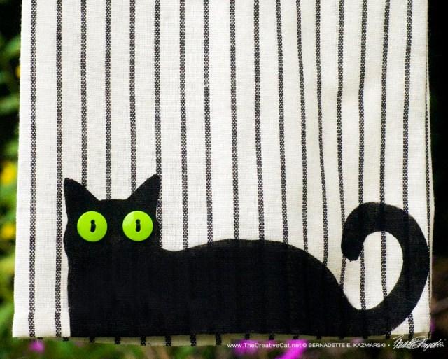 Bella! dishtowel on patterned towel, pattern B, narrow stripe.
