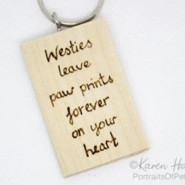 Paw prints on your heart keyring