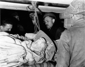 Monuments Man George Stout, second from right, with others as they remove Michelangelo's Bruges Madonna from the salt mine in Altaussee, Austria, July 10, 1945. AP Photo/National Archives and Records Administration.
