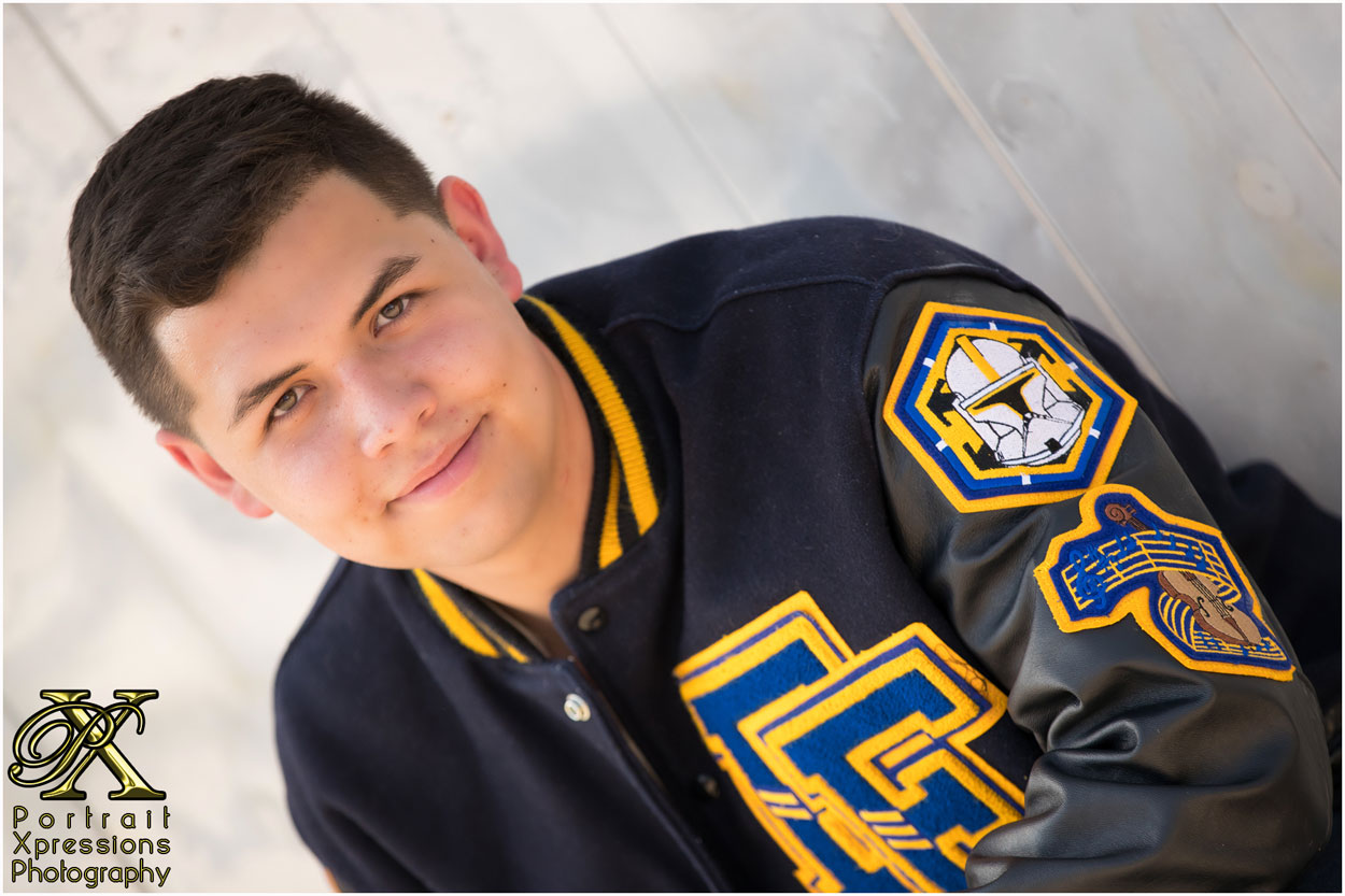 senior portraits with letterman jacket