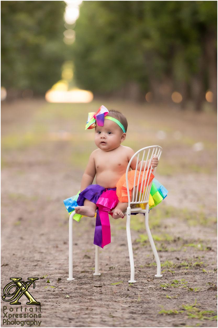 baby with rainbow tutu