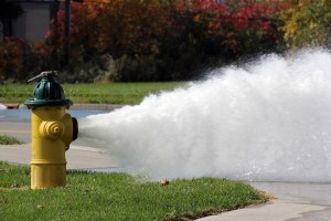 Hydrant spraying water to indicate flushing is in progress.
