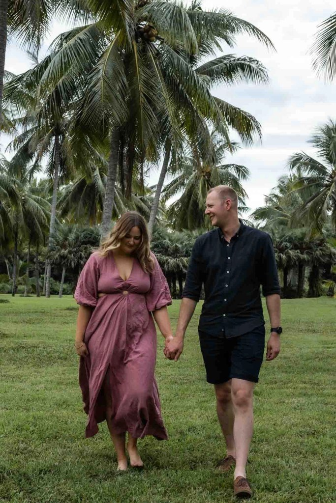 Thala beach nature reserve surprise engagement holding hands under palm trees