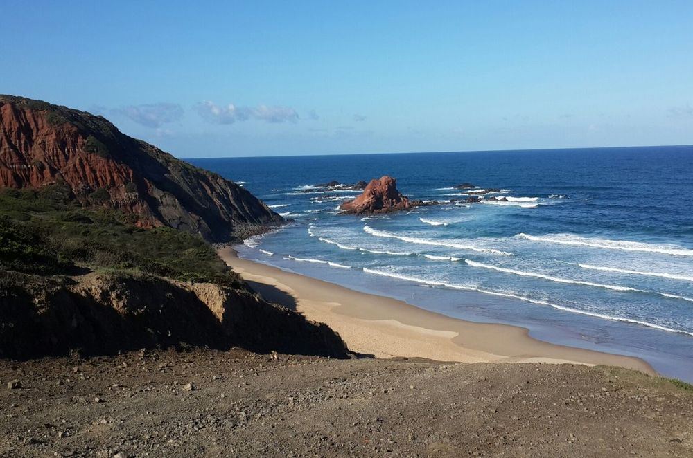 View from the hill on surfing waves on the Ponta Ruiva beach close to Sagres Portugal