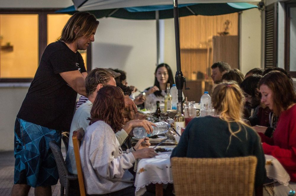 People eating dinner at the surf house in Santa Cruz