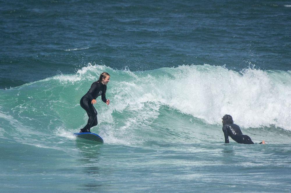 People surfing in Santa Cruz Portugal