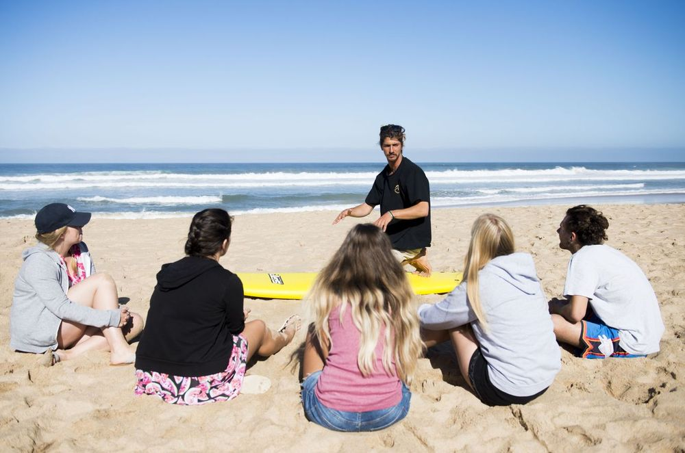 Surf lesson with a surf instructor on the beach in Ericeira Portugal