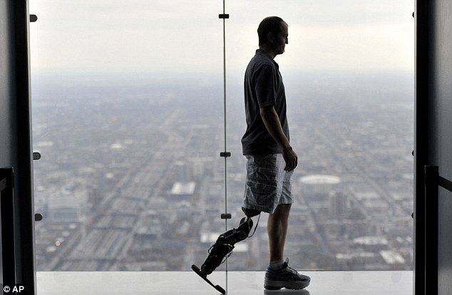 Thinking his way to the top: Amputee uses thought-controlled bionic leg to climb 103 flights of stairs to top of skyscraper   David Baker