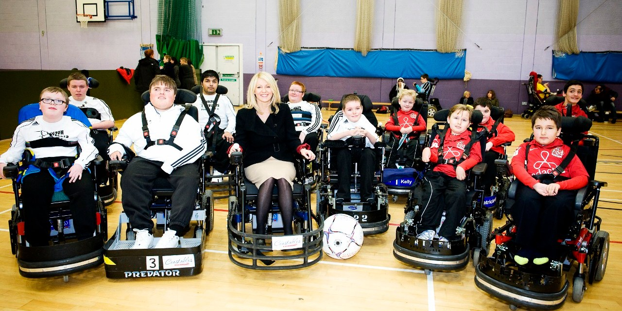 Powerchair players demonstrate skills to Minister