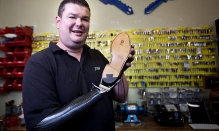 'The human Swiss Army Knife': Cobbler who lost his arm to cancer continues to work with prosthetic limb which can be fitted with interchangeable tools
